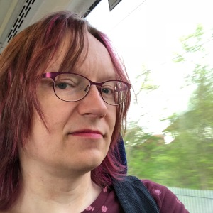 Anna on train with pink hair