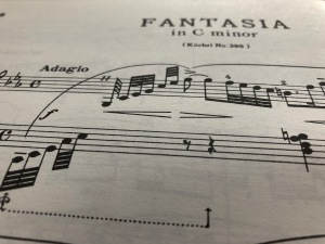 The title and opening bar of Mozart's Fantasia in C minor