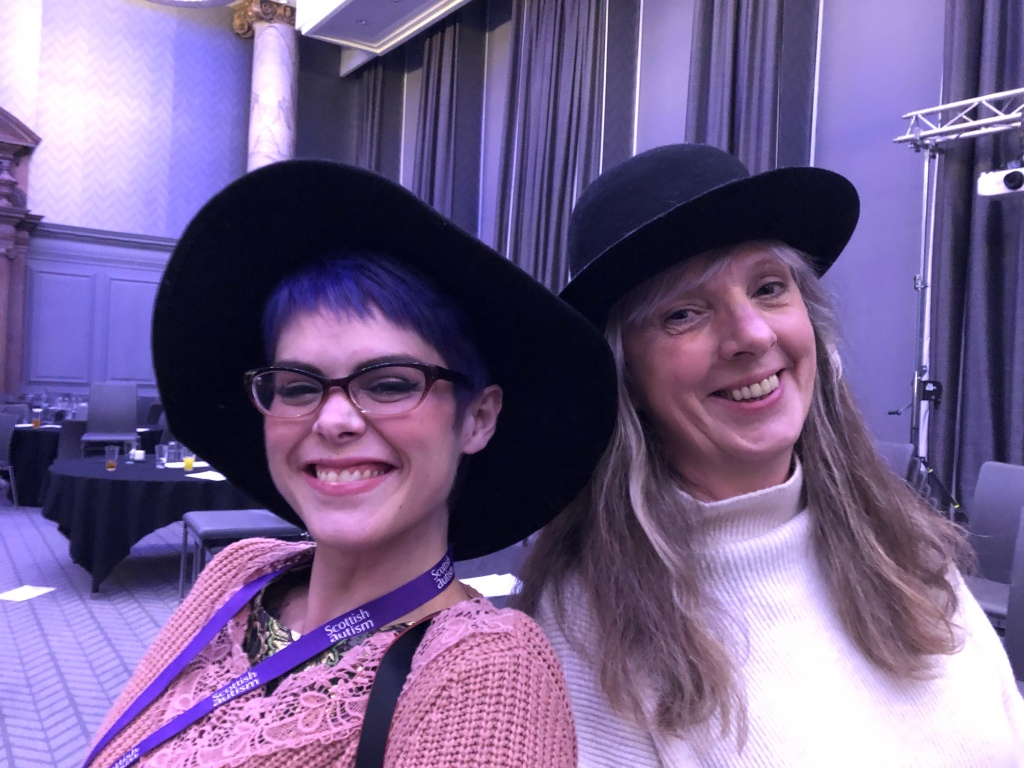 Sara Jane Harvey and Catriona Stewart, sporting wide-brimmed black hats